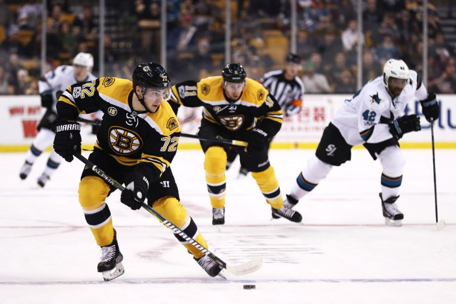 Bruins plays the Sharks in a hockey game.