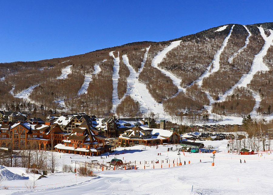 During the winter, tourists usually travel to ski resorts for vacation.