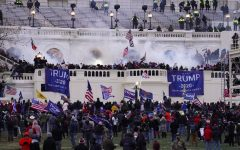 Trump supporters storm the Capitol in attempt to create change. (Source: John Minchillo)