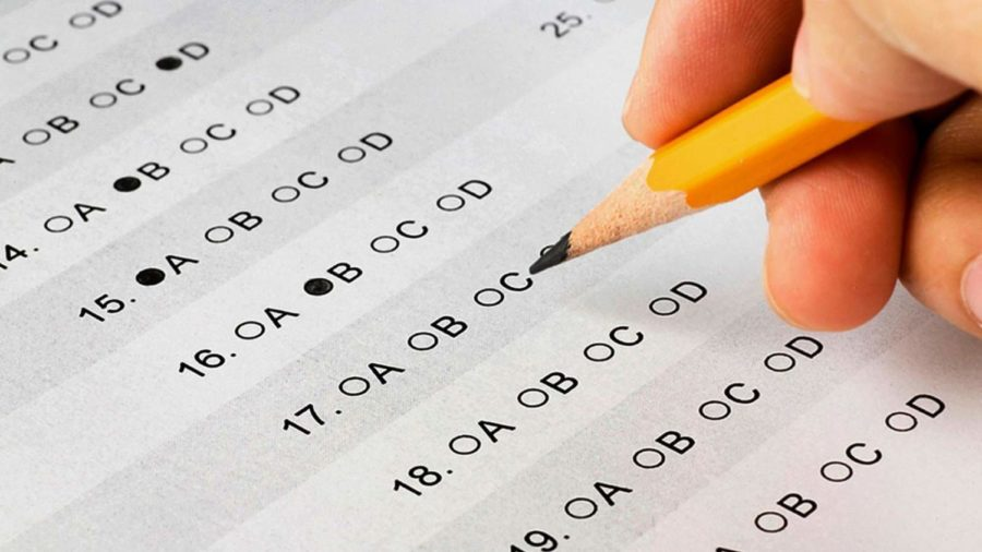 Colleges decide if they should remove SAT testing requirements.
