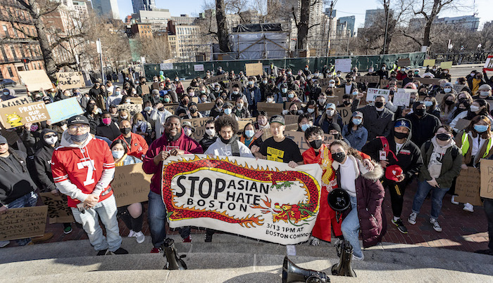 March 13, 2021, Boston Common, Boston, Massachusetts, USA: Protesters rally to protest discrimination and crimes against Asian and Pacific islanders during the Stop Asian Hate rally.